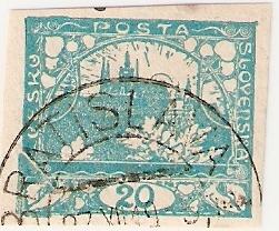 Zlomený ľavý dolný roh na známke Hradčany 20 h (?)